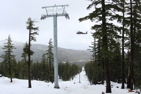 A helicopter places lift tower this summer at Mount Bachelor