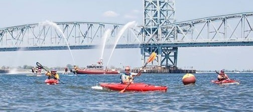 NEHSA instructor provides instructions for Wounded Warriors kayaking off Long Island, New York. (NEHSA)