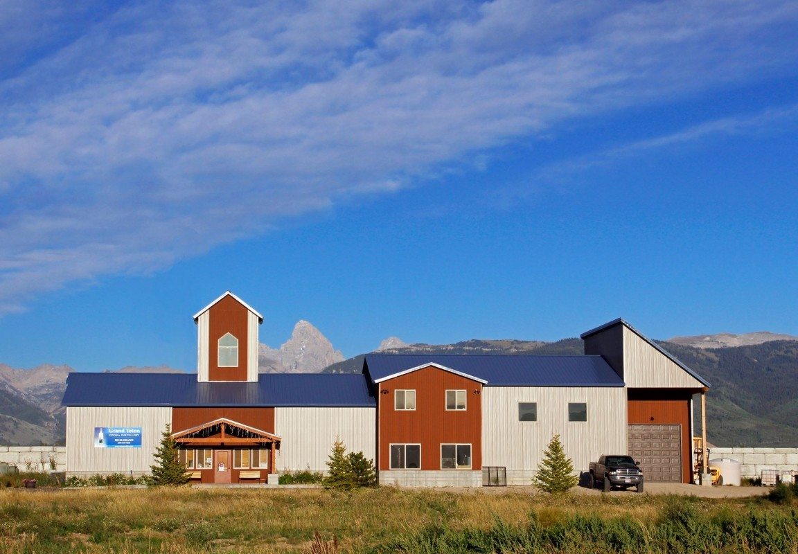 Tetons loom behind Grand Teton Distillery in Wyoming. (Grand Teton Distillery/Facebook)