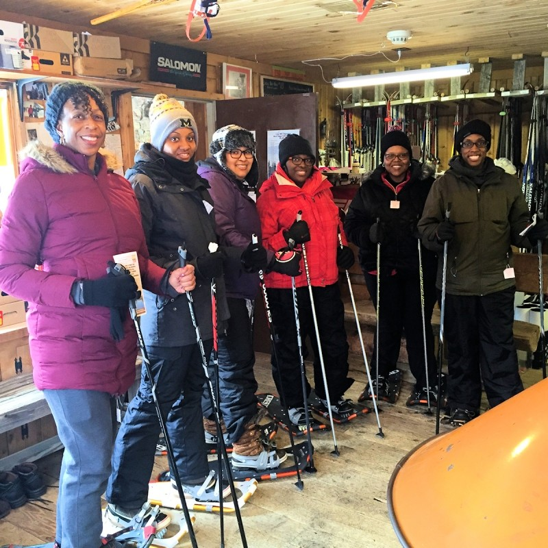 Getting set up for a family snowshoe adventure at Cross Country Ski Headquarters. (CCSHQ)