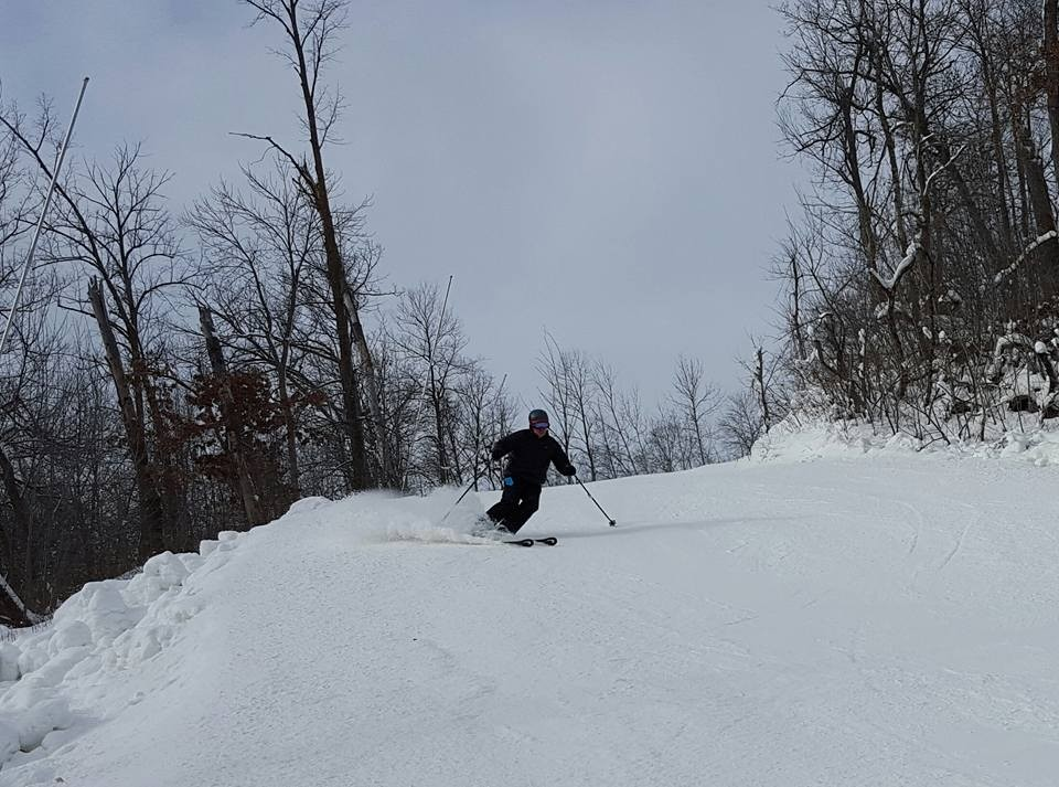 A senior skier takes a run down the backside of Welch Village. (Welch Village/Facebook)