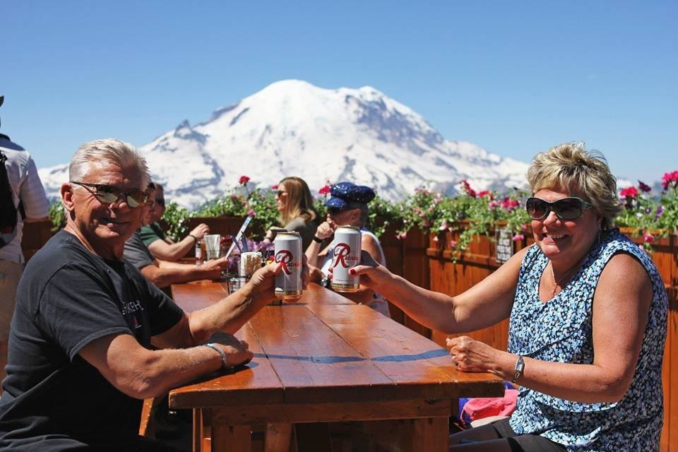 Havin' a brew with Mount Ranier in the background. (Crystal Mountain/Facebook)