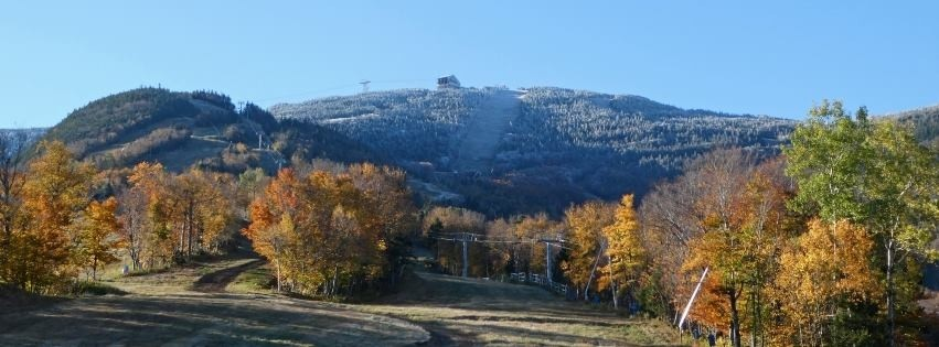 Winter begins to show above the fall foliage at Cannon. (Cannon/Facebook)