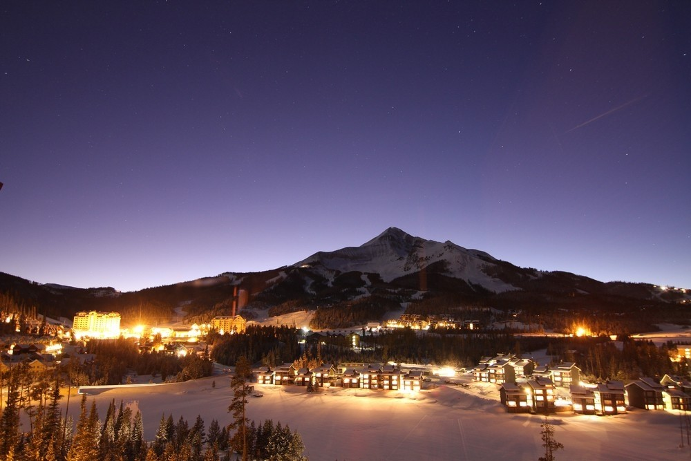 Big Sky village as dusk settles over the mountain. (Big Sky)