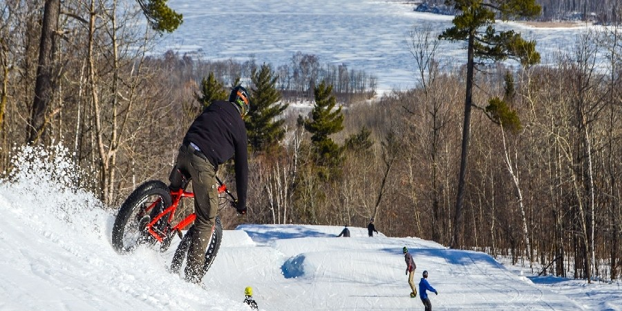 Fat tire bikers share the slopes with skiers on Sunday at Spirit. (Spirit Mountain)