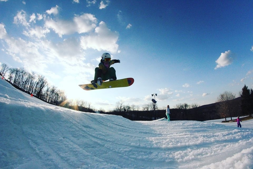 A snowboarder gets air in the terrain park. (Hidden Valley/Facebook)