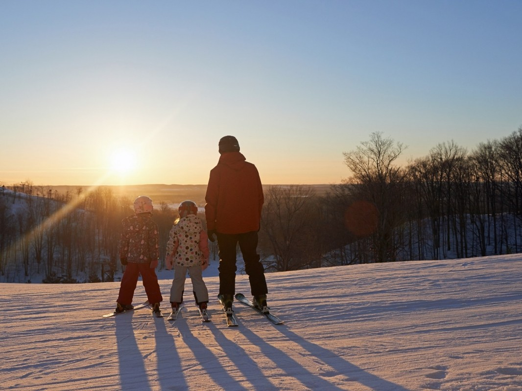 A family gets ready to enjoy an early morning run at Crystal Mountain. (Crystal Mountain)