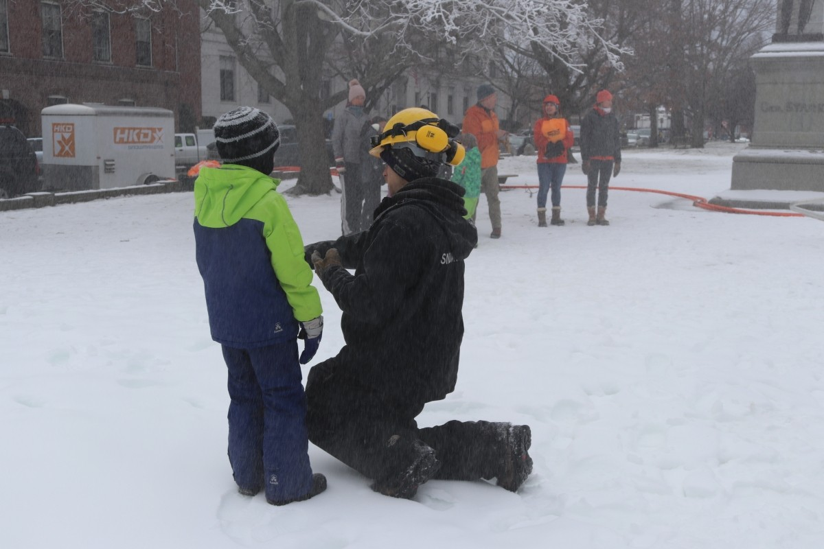 Learning about snow from a Pats Peak snow maker. (Martha Wilson)