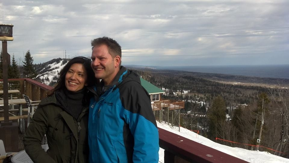 Enjoying a romantic moment on Moose Mountain with Lake Superior in the background. (Facebook/Lutsen Mountains)