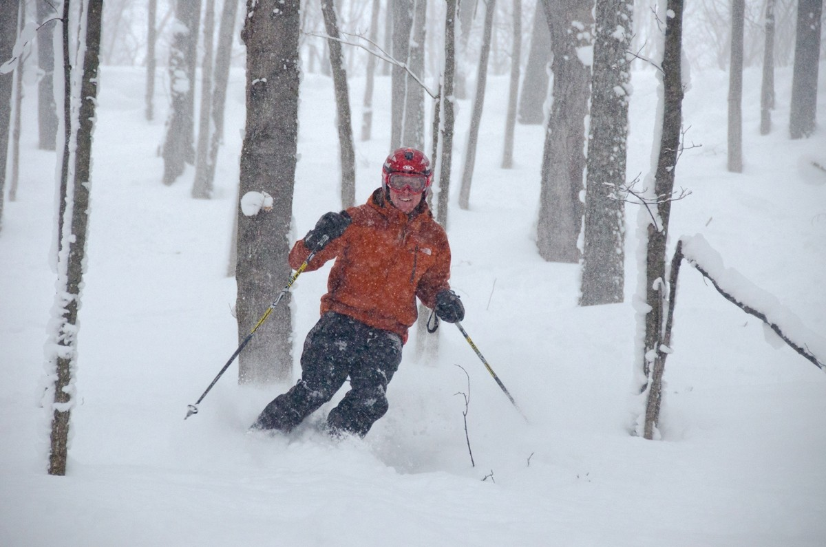 Happy skier in a powdery glade at Boyne Highlands. (Boyne)