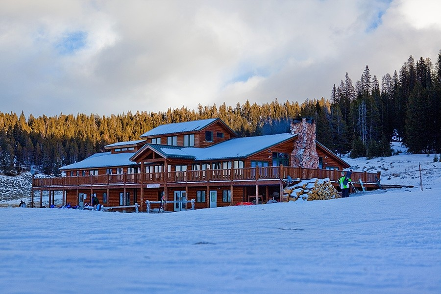 A rustic wood lodge greets skiers and boarders looking for rest and nourishment.  (Meadowlark Ski Lodge)