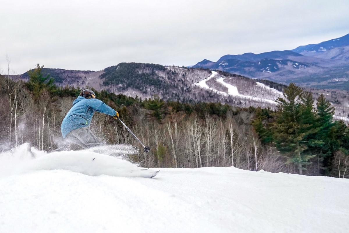A skier glides on packed powder at Attitash Resort in New Hampshire.